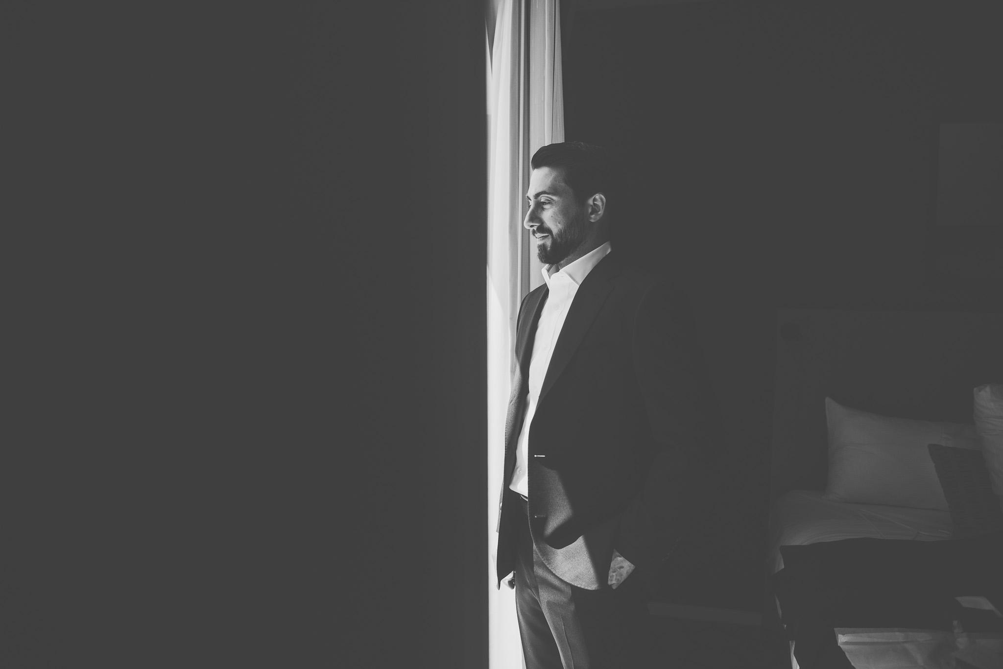 Downtown Toronto wedding, Toronto Wedding, Toronto Wedding Photographer, Downtown Toronto, Toronto Photographer, Berkeley Church, Berkeley Events, Berkeley fieldhouse, Groom, Groom getting ready, bowtie, cigar, black and white, portrait, window light, dramatic, groom getting dressed
